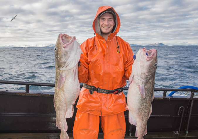 https://www.alaskaseafood.org/wp-content/uploads/201301-Fisherman-Two-Cod-JR-3.jpg