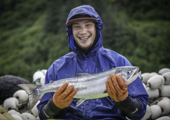 https://www.alaskaseafood.org/wp-content/uploads/201309-Fisherman-Close-Up-Salmon-JR-2-Web-JPG.jpg