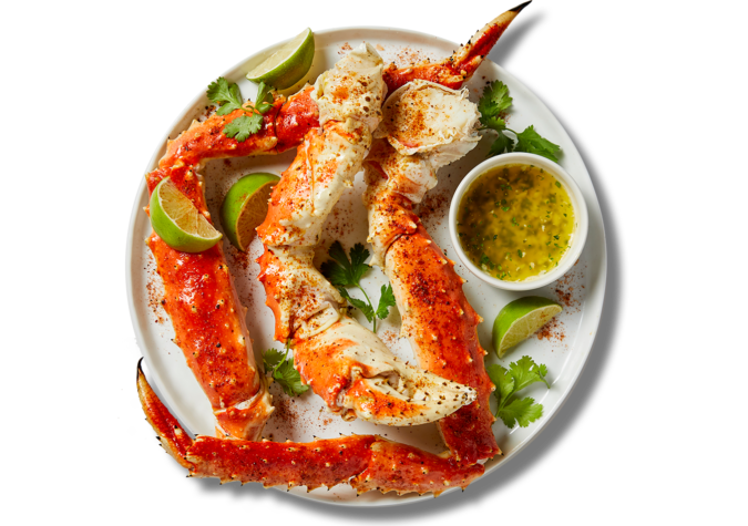https://www.alaskaseafood.org/wp-content/uploads/Crab-legs-and-chili-lime-oil.png