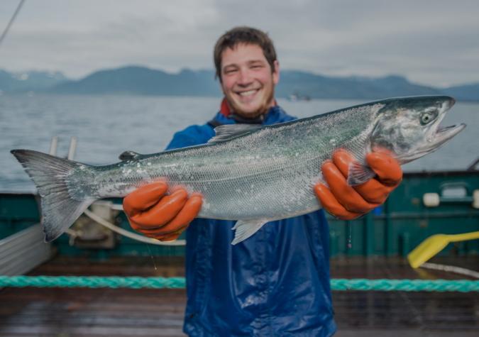 https://www.alaskaseafood.org/wp-content/uploads/Fisherman-holding-salmon-smiling_web.jpg
