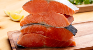 Stack of Alaska salmon portions on cutting board